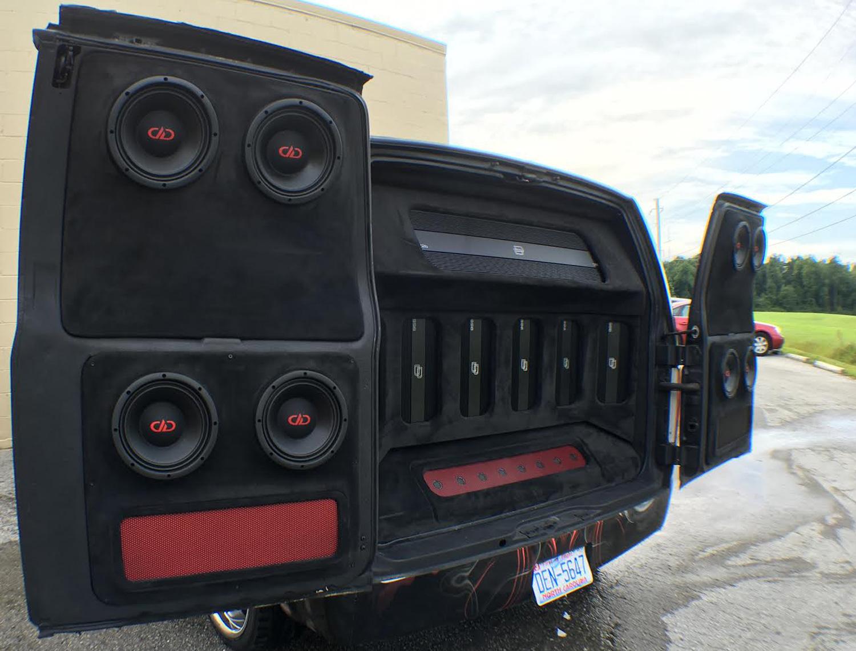 Street Sounds Astro Van Opened Up showing Door Speakers and amps