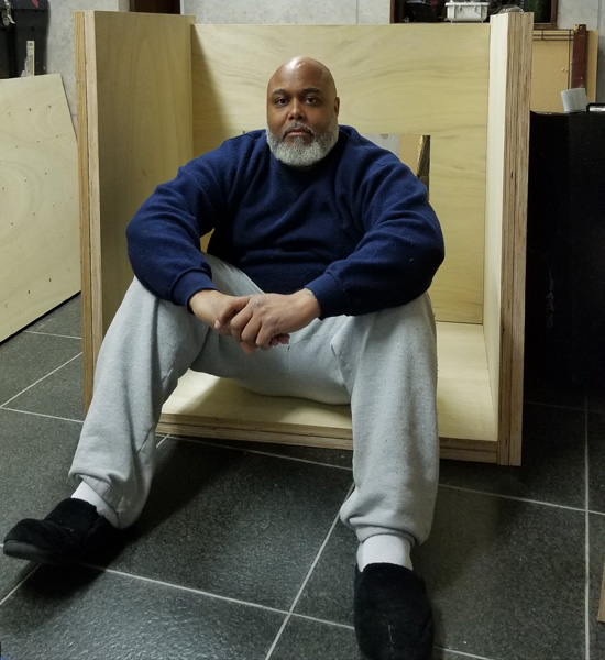 Khalif sitting in GoDDzilla enclosure