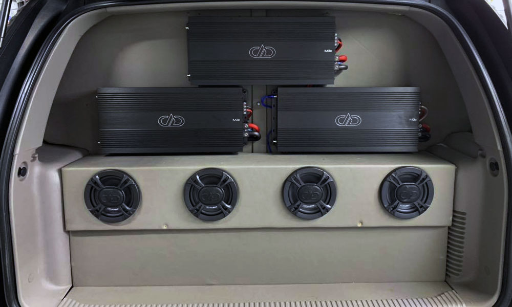 Photo of Custom work by Custom Audio - Amps and Coaxials in SUV rear