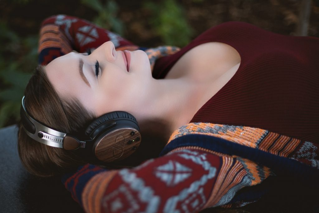 Photo of young woman relaxing with DXBT-05 headphones