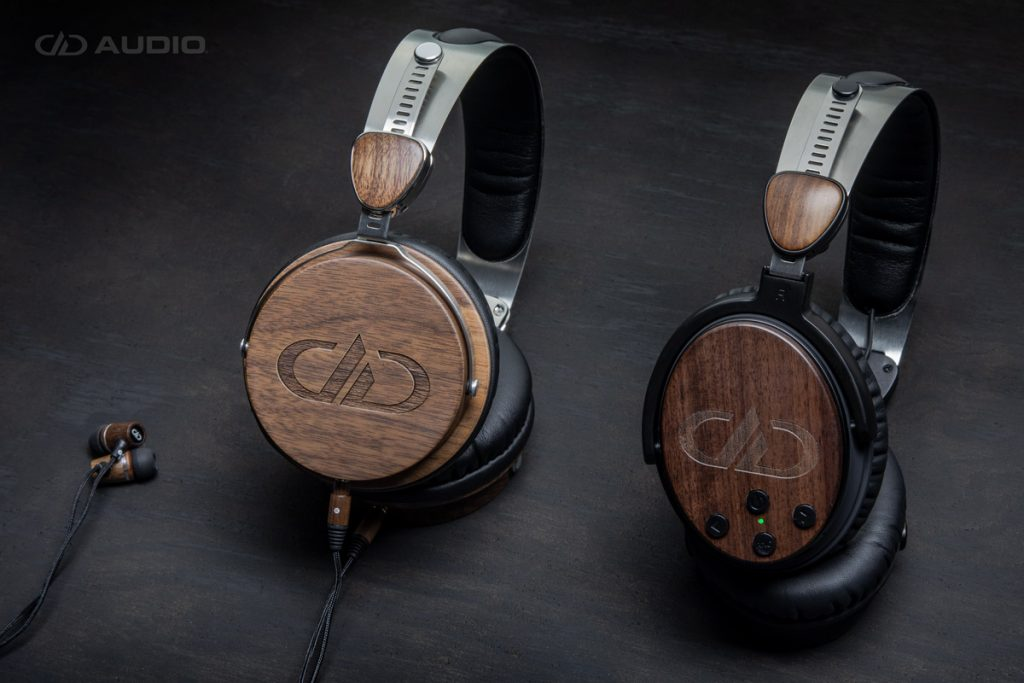 DXB-1.1 earbuds, DXB-04 and DXBT-05 headphones all in a beauty photo