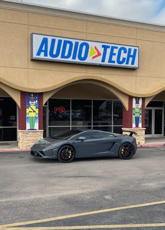 Audio Tech Front of Building with Sign and Lambo