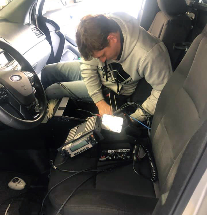 Audio Tech Installing Police Vehicle Equipment for Lawton PD
