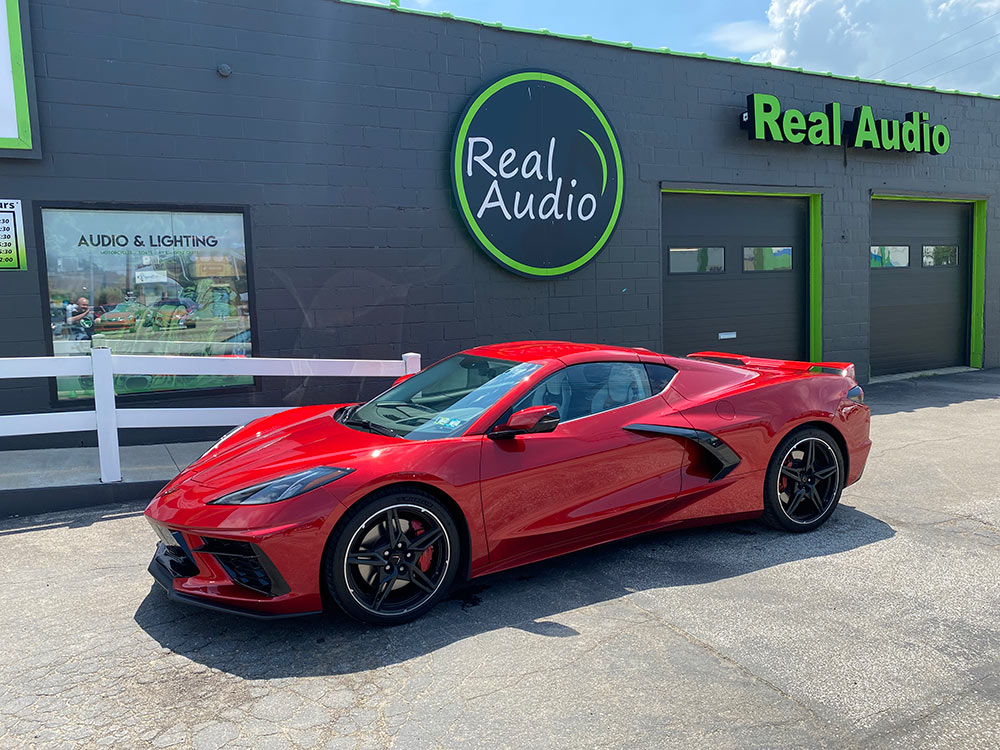 Picture of a new Corvette in front of shop